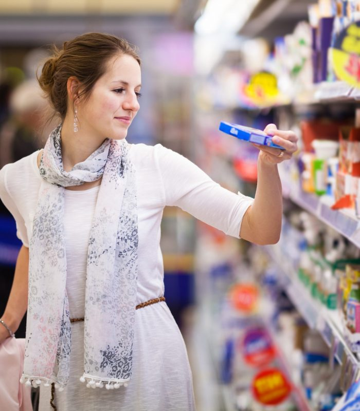 Female Shopper in Grocery Store Aisle
